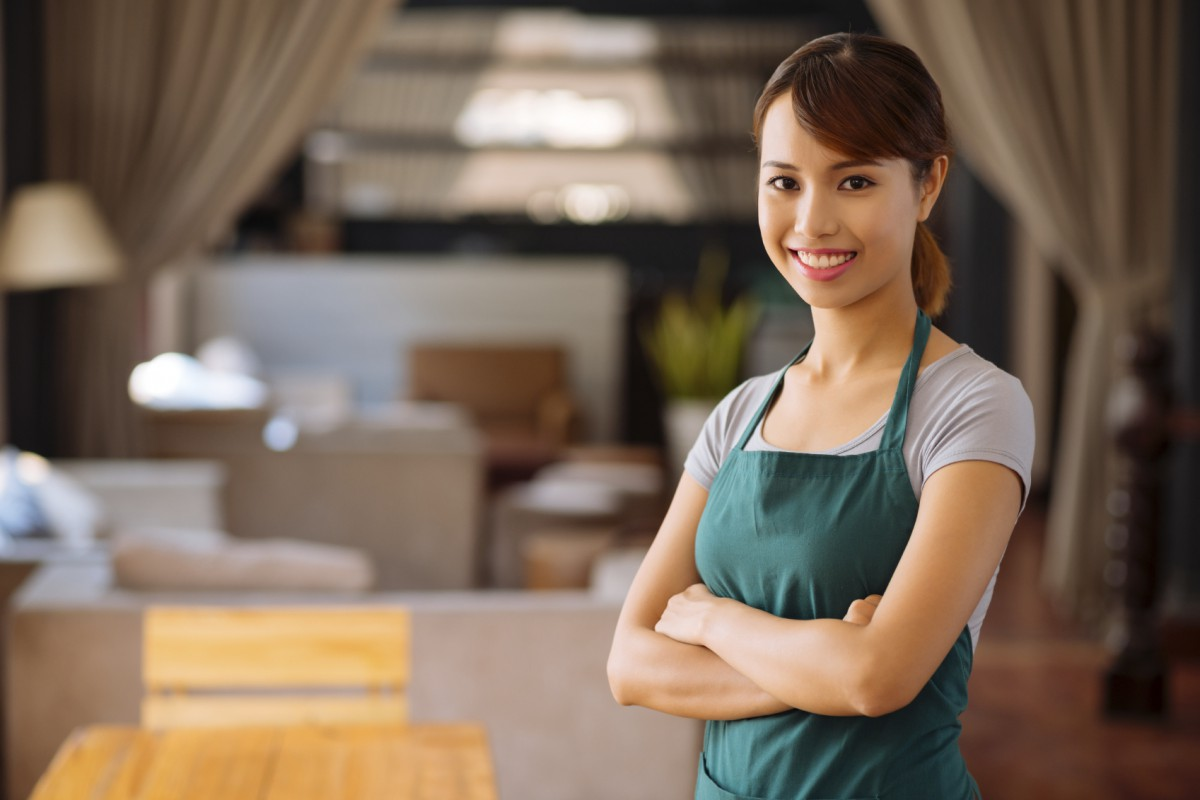 Portrait of young beautiful Asian cafe owner