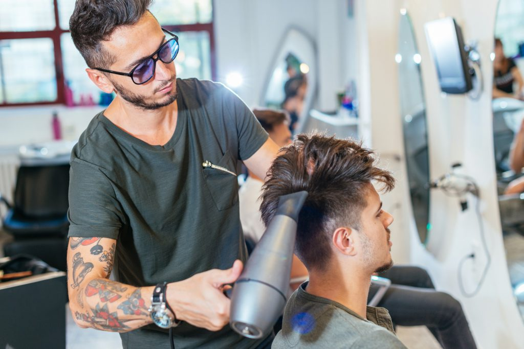 barbering program student giving a men's undercut