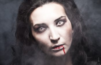 Halloween makeup on female vampire