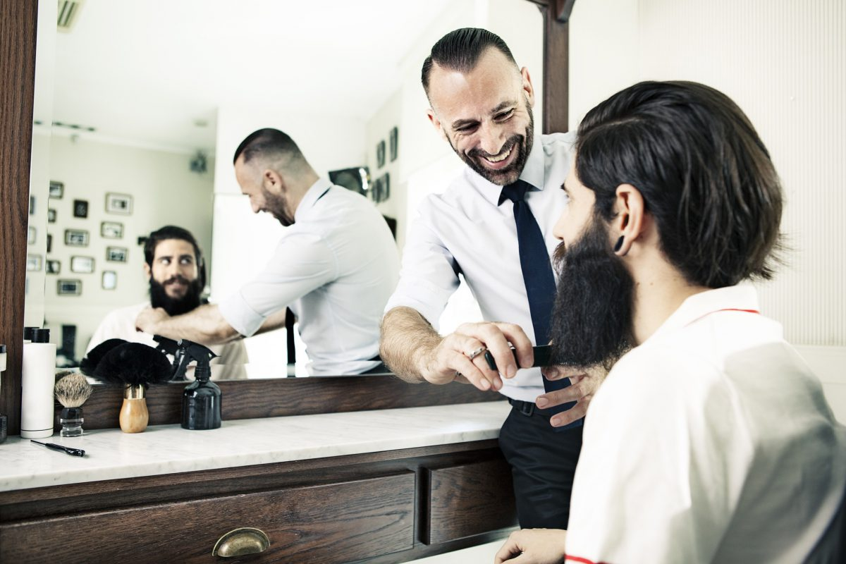 Barber with client in barbershop