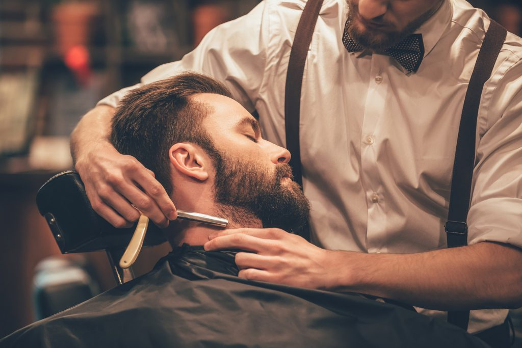 man getting a straight razor shave