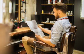 a man reading about barbering trends