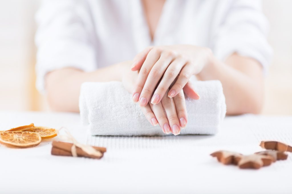 woman in spa getting her soft nails treated.