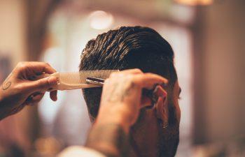 graduate taking his barbering licensing exam