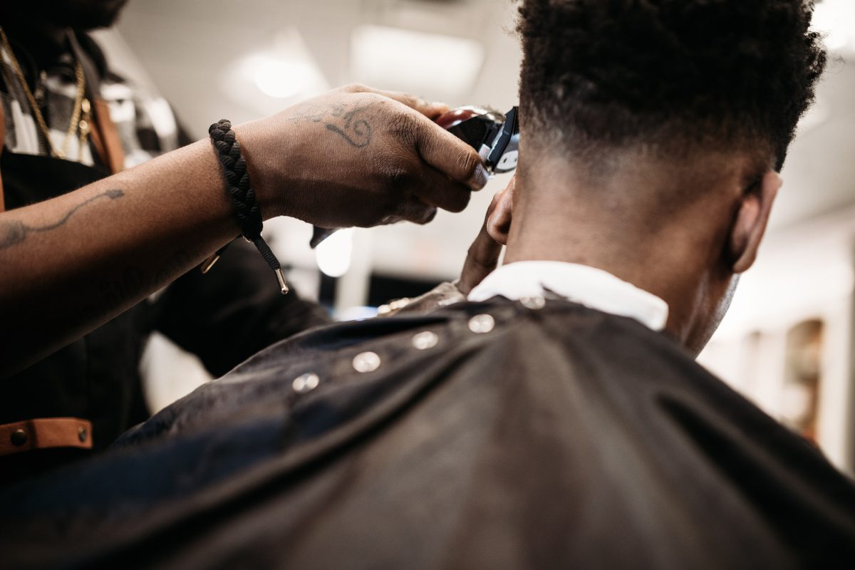Barber giving Men's haircut