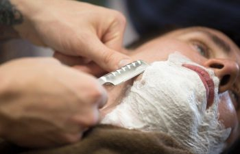 shaving face with a razor