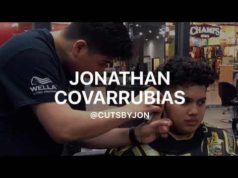 A barbering student at Salon Success Academy in West Covina California gives a haircut