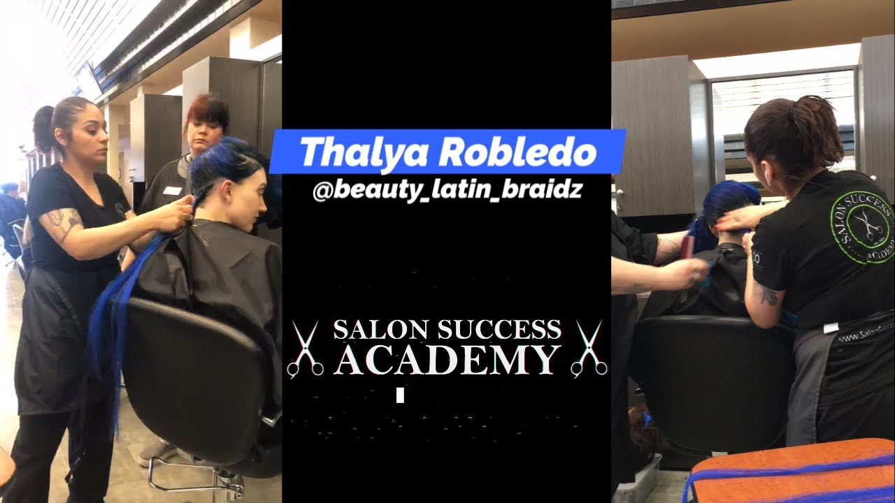 Student at Salon Success Academy, a beauty school in Upland California apply braids to another student
