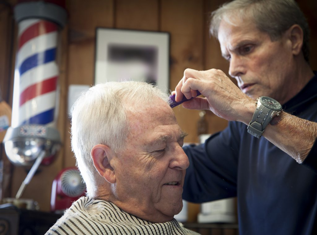 man getting haircut from barber