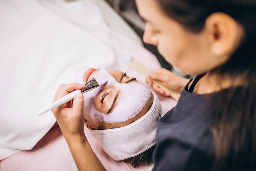 woman giving a facial